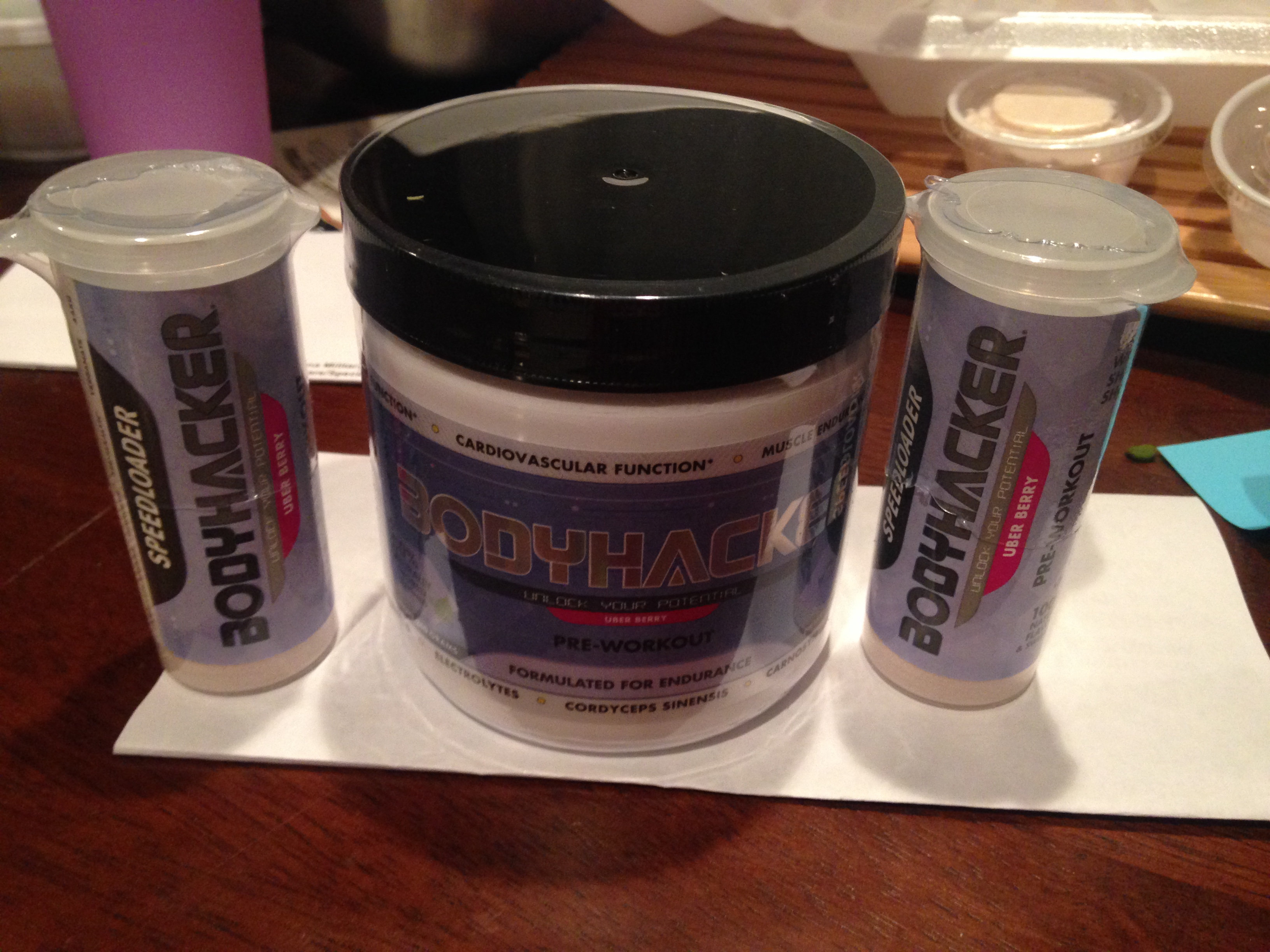 Full size container of Bodyhacker with two speed loaders.  Each speed loader has one serving allowing you to drink your pre-workout on the go quickly when traveling, pre-race or headed to the gym.