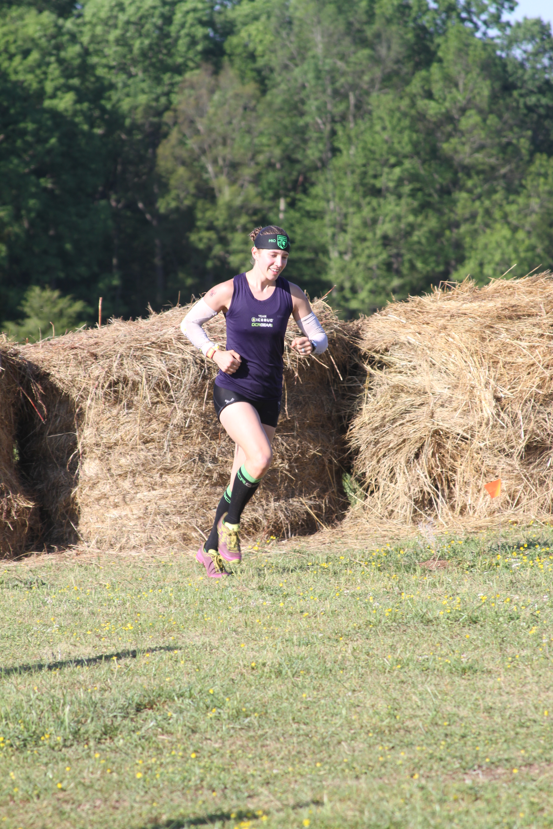 "CTG Pro Team Member Amy ""Magic"" Pajcic clearing hay bales on her way to 3rd spot on the podium."