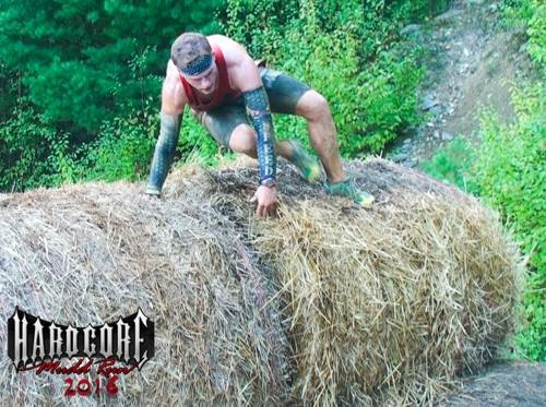 Logan Nagle clearing a hay bale obstacle.